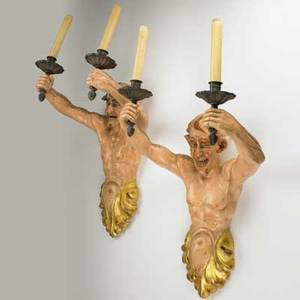 Pair of figural wall sconces carved wood with bronze candlesticks in the shape of satyrs with polychrome decoration 20th c electrified 26 x 15 x 12