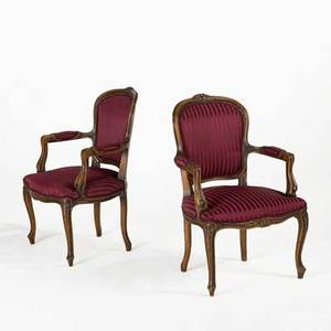 Pair of louis xv style armchairs walnut frames with upholstered seats and backs 20th c 35 x 23 x 22