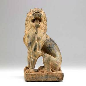 Chinese figure of a seated buddhist lion deeply carved limestone with traces of pigment seated on block base tang dynasty 8th c 12 14 x 6 14 sq provenance private collection new york gi