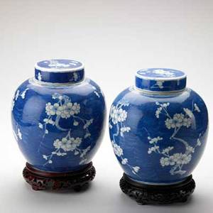 Pair of chinese covered ginger jars blue and white porcelain on wood bases 20th c 11 14 with base
