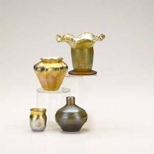 Tiffany four items early 20th c miniature pulled feather vase toothpick holder miniature ribbed vase and pulled feather vase some marked tallest 4 12