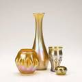 Tiffany four favrile items early 20th c ribbed vase lily pad tumbler thorn salt and low vase all marked tallest 9 12