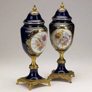 Pair of porcelain urns dore bronze mounted with floral decoration 20th c 16 12 x 5