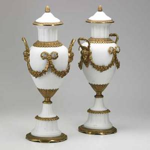 Pair of parian urns wreath and vine decoration with dore bronze mounts 20th c 23 12 x 9 x 8