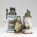 Three german steins two regimental dated 1894 and 1913 together with a figural stein of a friar late 19thearly 20th c tallest 9 12