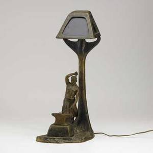 Figural bronze lamp depicting a blacksmith colored glass shade 20th c 23 x 8 12 x 12