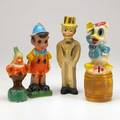 Carnival prize figurines four 20th c donald duck pinocchio doc and charlie mccarthy tallest 12 14