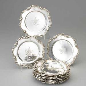 Twelve american sterling bread and butter plates undulating rim with floral ornament heraldic crests in center script monogram l on border marked 925 1000 and sterling 73 ot each 6 12