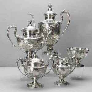 Redlich  co ornate silver coffee service ca 1900 5 footed pieces with chased repousse floral and scroll panels acanthus borders handles and spout flower basket finials coffee pot 10 14