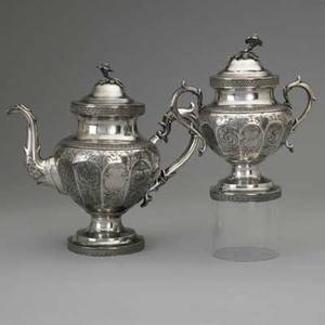 American coin silver by ball tompkins  black ca 1853 faceted bulbous coffee pot and covered sugar bowl with engraved scroll decorations anthemion ribbons and flower finials presentation inscrip