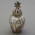Viennese silvergilt and enameled jar ca 1890 the vessel in the shape of a ginger jar with pierced cover and figural finial of st george fighting the dragon concentric bucolic enameled scene inha