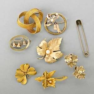 20th c gold jewelry eight pieces includes 18k gold knot brooch tiffany  co kilt pin 18k gold orchid american 14k gold jewelry includes four brooches and floral earring clusters for unpierced ea
