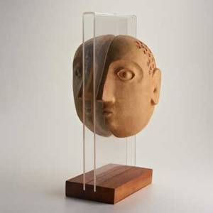 David gilbennington pottersstoneware face sculpture on acrylic and wood base bennington vt 1990sunmarked19 x 10 x 6