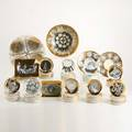 Piero fornasettiapproximately seventyfive pieces including giltdecorated bowl plates and coaster sets italy 20th cmost marked for fornasetti milanobowl 4 x 9 dia