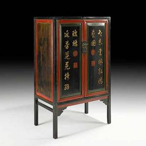 Asian black lacquer cabinetpaneled doors with calligraphic decoration and interior drawers 20th c59 x 36 12 x 21