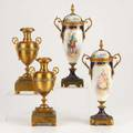 Sevresetctwo pair double handled urns19th20th c lidded sevres hand painted and bronze mounted together with champleve bronzesevres markedtallest 12
