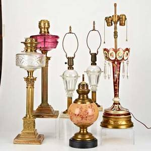 Traditional lightingsix pieces including two victorian brass and glass oil lamps pair converted whale oil lamps cranberry luster converted to lamp asis etctallest 18