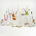 Italianczech glass etcapproximately twentynine pieces including perfume bottles decanters ashtrays vase dresser set salt and pepper shaker setmany marked for irving ricetallest 13 12