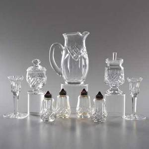 Waterfordnine pieces 20th c pitcher pair of candlesticks two relish jars and two pairs of salt and pepperssignedpitcher 7 12