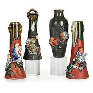 Sumida gawa pottery four vases with figures in relief two on red ground and two on black ground early 20th c all marked tallest 9 12