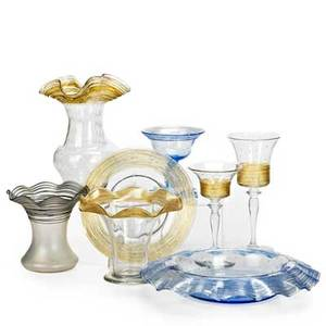 Steuben attr sixteen threaded glass items 20th c three piece console set in blue eight pieces of yellow stemware two yellow vases two yellow plates and a verre de soie vase eight shown co