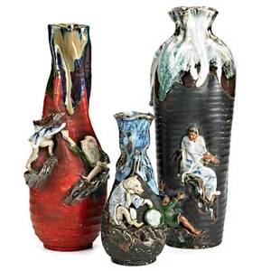 Sumida gawa pottery three pinched top vases early 20th c one with dog in relief on black ground one with a bird on black ground and the third with two figures on red ground all marked 12 14
