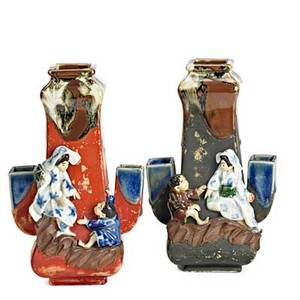 Sumida gawa pottery pair of vases with woman and child in relief on brown and red ground early 20th c illegibly marked 8 14