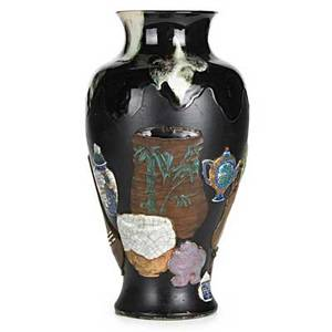 Sumida gawa pottery urnshaped vase with applied decorations of japanese ceramics on black ground ca 1900 ryosai mark 18 14