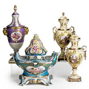 Sevres porcelain four items 19th20th c covered center bowl with gilt and floral decoration pair of covered urns and a lidded urn with rams head handles all marked tallest 16 12