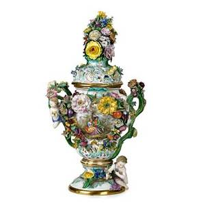 Meissen porcelain handpainted porcelain covered urn with applied putti and large floral finial 19th c crossed swords mark 24 x 12 x 9 12