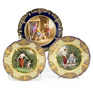 Dresden  sevres porcelain plates three with handpainted genre scenes and elaborate gilded borders early 20th c largest 9 14 dia