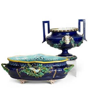 Continental majolica centerpieces two 19th c large oval bowl with bird decoration and bowl with satyr decoration larger 6 12 x 20 x 11