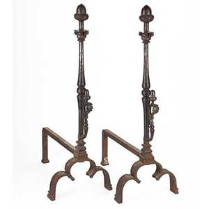 In the style of samuel yellin pair of wrought iron andirons with acorn motif unmarked 34 x 11 12 x 22 provenance property of a private collector delaware