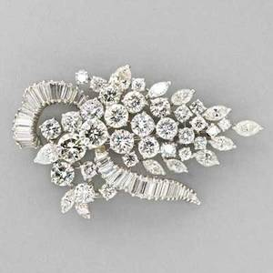 Platinum diamond brooch van clief ny ca 1955 stylized grape cluster and ribbon designed in high relief two circular brilliant cut diamonds approx 105 cts each one approx 1 cts twentyseve