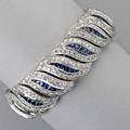 18k white gold diamond and sapphire bracelet flexible ribbon of leafshaped links bead set brilliant cut diamonds 609 cts tw and channels of french cut sapphires 1344 cts tw 395 dwt 615