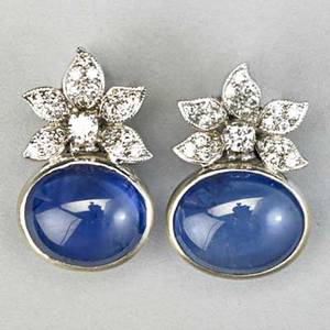 White gold sapphire and diamond earrings oval sapphire cabochons each approx 6 cts bezel set below diamond blossoms approx 84 ct tw marked 750 58 dwt 9 gs 910