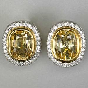 Fashionable yellow sapphire and diamond earrings bright faceted cushion cut sapphires each approx 6 cts in 18k yg within micro pave diamond platinum halos clip backs for unpierced ears 113 dw