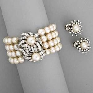 Diamond and pearl bracelet and ear clips bracelet consists of four strands of lustrous spherical akoya pearls 7572 mm diamond 14k wg spacer and floral clasp with 2 x 92 mm pearls sprayform e