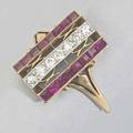 Art deco diamond and ruby ring designed as an open filigree with channels of square rubies in 14k yg separated by a row of diamonds in platinum ca 1925 14 dwt 22 gs size 4 34