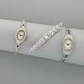 Two diamond watches and a brooch 19351950 oblong platinum brooch with oec and rose cut diamonds in engraved openwork 2 12 lozengeshaped platinum diamond watch on double row platinum strap with