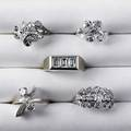 Five white gold diamond rings mid 20th c one with three rectangular diamonds approx 120 cts tw four floral or cluster motifs with circular or marquiseshaped diamonds approx 4 cts tw throug