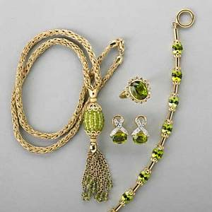 Assembled suite of gold peridot jewelry 18k gold bracelet ring and earrings 14k gold woven necklace diamonds approx 1 cts tw largest peridot approx 6 cts total peridots approx 23 cts 414