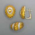 18k gold yellow sapphire and diamond jewelry teardropshaped leverbacked earrings and a ring ca 1999 bombe forms pave set yellow sapphires with white gold diamond accents 20 cts and 77 ct 2