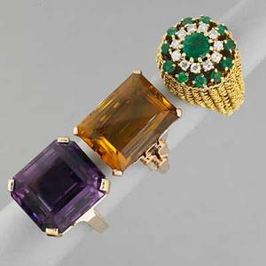 Three jeweled gold rings mid 20th c emerald cut citrine and an octagonal cut amethyst each 20 cts in 14k yg 18k gold twisted wire ring with emerald and diamond circular cluster boss 232 dw