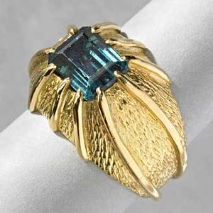 Schlumberger 18k gold tourmaline ring tiffany  co emerald cut bluegreen tourmaline in textured bombe in original box marked 77 dwt 12 gs size 7