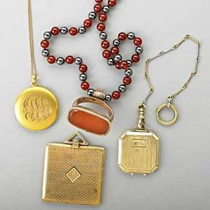 Gold or goldfilled lockets and fobs 19th20th c four pieces square engineturned 14k gold locket octagonal 10k gold locket on 14k gold chain round 10k gold locket and chain gf carnelian fob