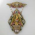 Hungarian enameled silvergilt jeweled brooch elaborate festoon corsage ornament in the hungarian revival style depicts nesting swan and fledglings among garnet flower heads and pale amethysts red