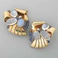 Raymond yard moonstone sapphire clips mirror pair of clip brooches designed as volutes set with cabochon moonstones faceted blue sapphires and diamond platinum accents ca 1943 marked yard inc