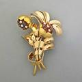 Jeweled 18k gold victory bouquet clip brooch gubelin swiss ribbontied blossoms with prong set ruby and diamond or sapphire and diamond clusters hinged doublepin ca 1945 146 dwt 227 gs