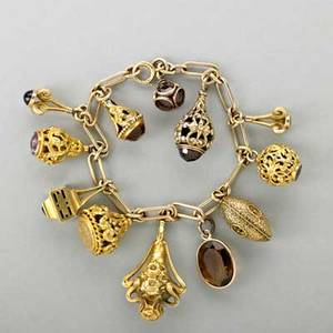 Antique gold charm bracelet 14k gold links suspend eleven gold charms most revised jeweled hat pins and a gf garnet orb 259 dwt gw 403 gs gw 7 12